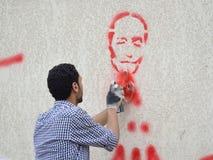 Artitist die van Graffiti de Militaire Raad critizing Royalty-vrije Stock Fotografie