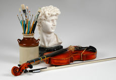 The Arts. Representation of the arts by violin, sculpture, and painting Stock Photography