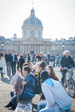 Arts bridge across river Seine with group of peopli Stock Photography