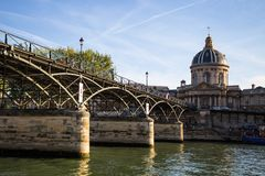 Arts Bridge Pont des Arts with the Institute of France in Paris, France stock images