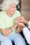 Arts Comforting Senior Woman stock foto's