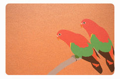 Arts of couple parrots on sandpaper Stock Images