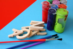 Arts and Crafts. Paint, brushes and wooden items Royalty Free Stock Photo