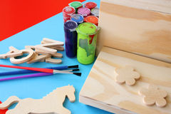 Arts and Crafts. Paint, brushes and wooden items Stock Photos