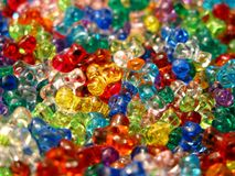 Arts and Crafts Beads. Lots of different colored arts and crafts beads stock image