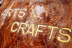 Arts and crafts inscription. On a wooden board Royalty Free Stock Images