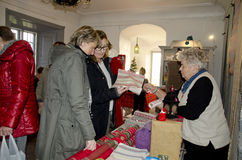 Arts and Crafts market at Christmas. Indoor arts and crafts market at Christmas in Bosjökloster, Sweden lights and decorations, ladies looking at the vendors royalty free stock photos