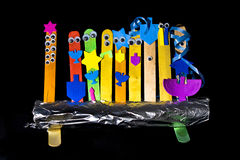Arts & Crafts Menorah, isolated on black. A homemade arts & crafts menorah for Hanukkah, on black Royalty Free Stock Images