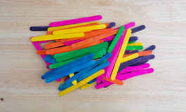 Arts and crafts sticks on a wood table Royalty Free Stock Photography