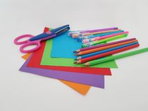 Arts and Crafts Supply, Kids Crafts, Back To School, School Supplies. Colored craft paper with colored pencils laying on a white background, Art teacher, Craft stock photos