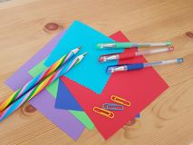 Arts and Crafts Supply, Kids Crafts, Back To School, School Supplies. Colored craft paper with colored pencils laying on a wooden background, Art teacher, Craft royalty free stock photos