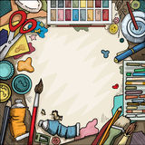 Arts and crafts table. Background, Ariel view of arts and crafts table with various objects surrounding a blank piece of paper stock illustration