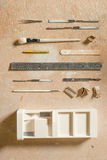 Arts and Crafts Tools and a Plaster Building Scale Model Royalty Free Stock Image