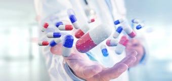 Arts die een 3d teruggevende groep medische pillen houden Stock Afbeeldingen
