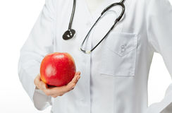 Arts die gezond voedsel adviseert Stock Fotografie