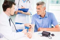 Arts en Patiënt Stock Foto