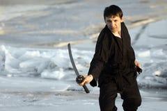 Arts martiaux avec l'épée photographie stock