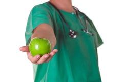 Arts met een appel op zijn hand Stock Fotografie