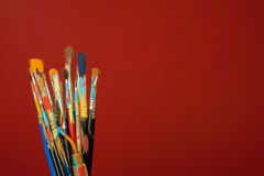 Arts painting brushes with red background Stock Photo