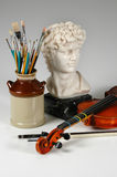 The Arts Still Life. The arts represented by a still fife with sculpture, music and painting Royalty Free Stock Photography