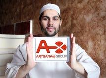 Artsana pharmaceutical company logo. Logo of Artsana pharmaceutical company on samsung tablet holded by arab muslim man. Artsana Group is an Italian company Stock Photo