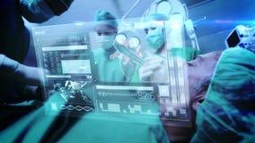 Artsen die recentste technologie gebruiken stock video