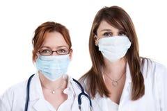Artsen en chirurgische maskers Royalty-vrije Stock Afbeelding