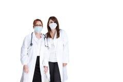 Artsen en chirurgische maskers Royalty-vrije Stock Foto's