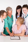 Artsen en een patiënt Stock Foto