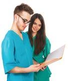 Artsen met een omslag Stock Afbeeldingen