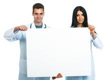 Artsen met een raad Royalty-vrije Stock Afbeelding