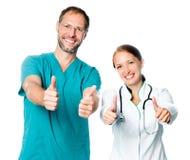 Artsen met omhoog duimen Royalty-vrije Stock Fotografie