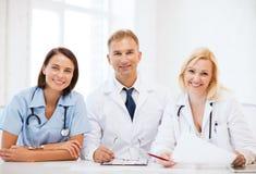 Artsen op een vergadering Stock Afbeelding