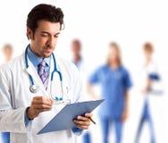 Artsenportret met zijn team Stock Afbeelding