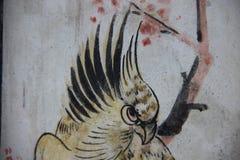 artsiest 在寺庙墙壁鸟和植物上的绘画 库存图片