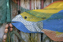 Artsy fish on weathered wall Royalty Free Stock Image