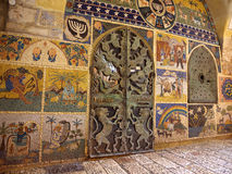 Artsy metal gate in Jerusalem. An artistically sculpted gate made of metal surrounded by beautiful mosaic work representing scenes from the history of Judaism Royalty Free Stock Photography