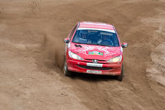 Artur Gayanuzyan drives a red Peugeot 208 Stock Photography