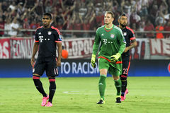 Arturo Vidal (R) Manuel Neuer (c) e Douglas Costa (L) durante t imagens de stock royalty free