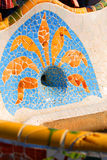 Artwork in Barcelona. A closeup view of mosaic artwork by the designer, Gaudi, found in Park Guell, a famous public park and landmark in Barcelona, Spain stock photo