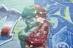 Artwork on brick wall stock photography