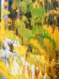Artwork Brush Strokes Detail. Close-up details of oil acrylic paint brushed on the canvas by a talented artist. Bright shades of yellow, green and white with Stock Image