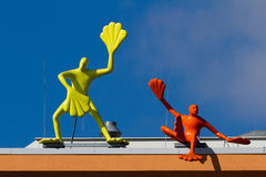 Artwork on building. Two colorful sculptures on a building.  Blue sky background.  Dusseldorf, Germany Royalty Free Stock Photos