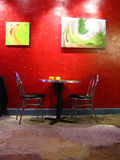 Artwork in cafe. Artwork on red wall in cafe Royalty Free Stock Photo