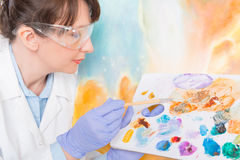 Artwork conservator at work Stock Photo