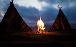 An old native american teepee in the desert. Artwork decoration creative concept. An old native american teepee in desert at the evening. Wigwam house indian stock photos
