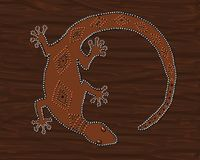 Brown Gecko Lizard. This artwork depicts Australian style dot painting of a brown gecko lizard on a dark brown background Royalty Free Stock Photos