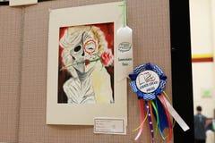 Artwork on display at local art fair. Artwork with a prize on display on an art fair in a local school royalty free stock image