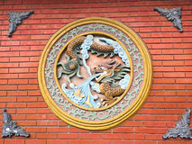 Artwork with dragons on a wall Stock Photography