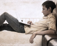 Artwork in grunge style, boy with laptop Royalty Free Stock Images